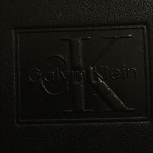 Calvin Klein means black leather wallet